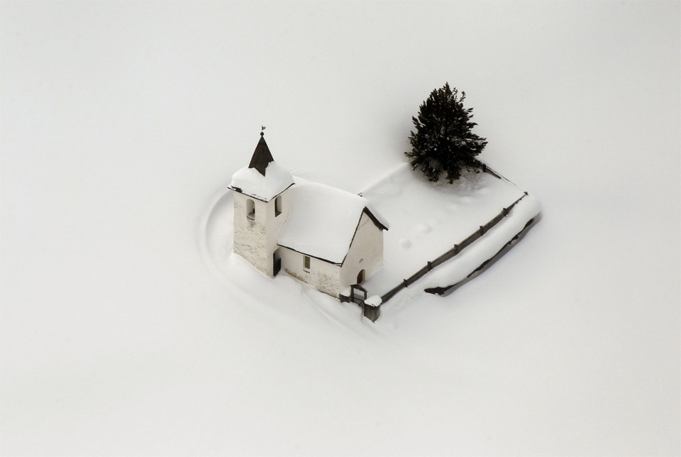 church-in-switzerland-surrounded-by-snow