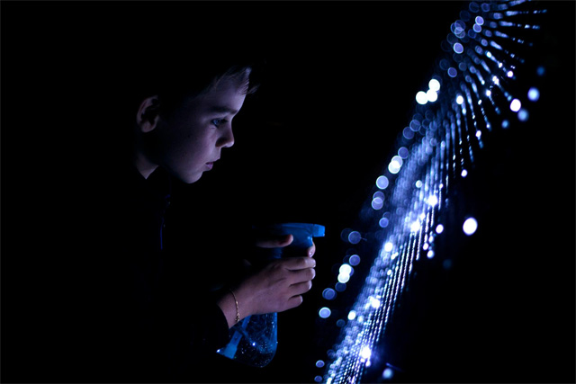 Water Light Graffiti: A Moisture-Sensitive Surface Embedded with LEDs Creates Illuminated Art