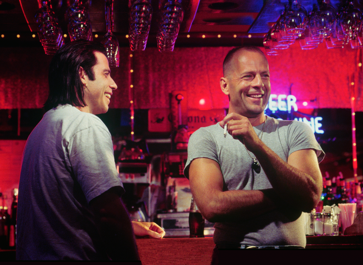 Джон Траволта и Брюс Уиллис на съёмках «Криминального чтива», 1994