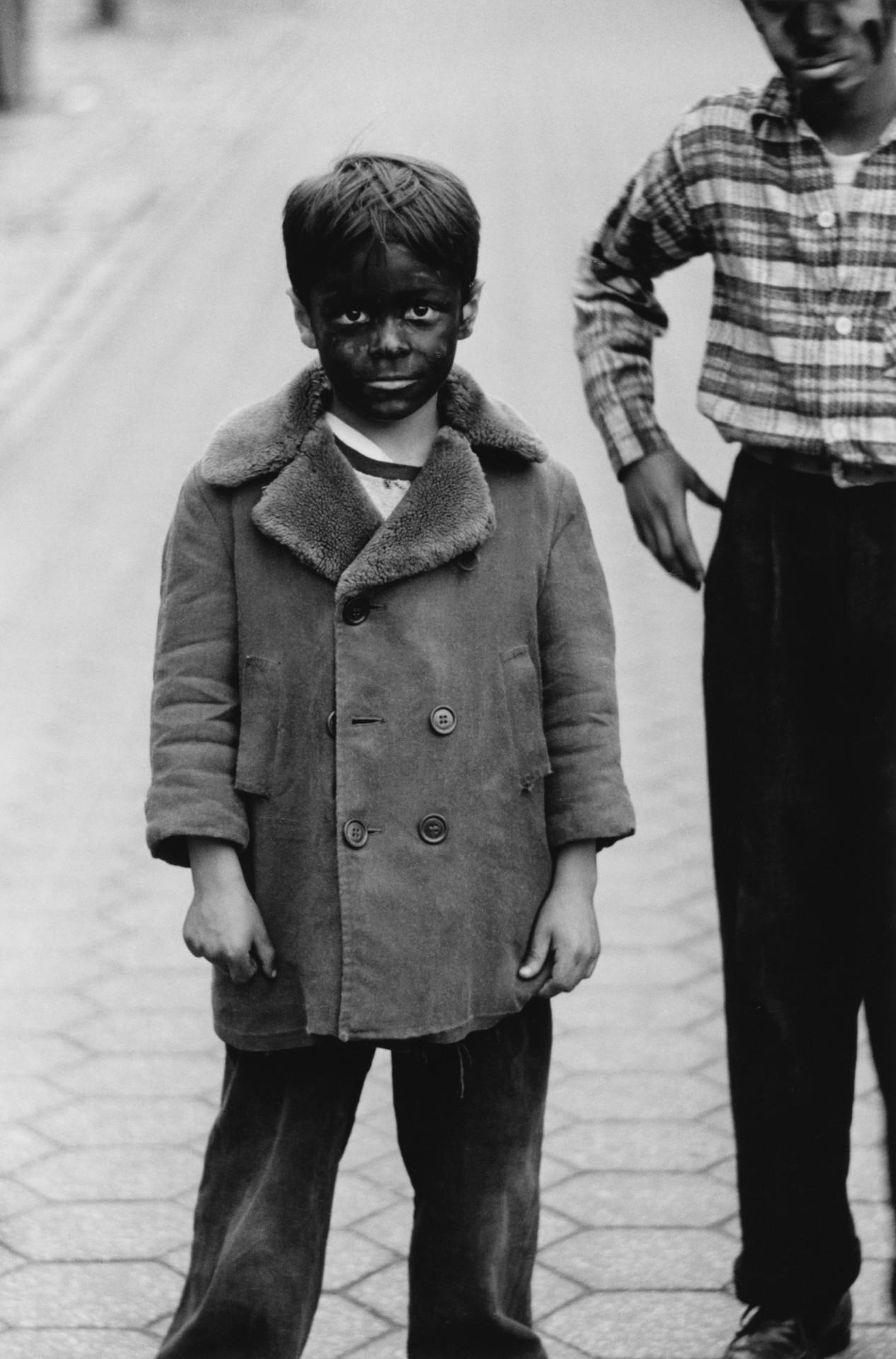 Ребёнок с чёрным лицом, 1957. Фотограф Диана Арбус