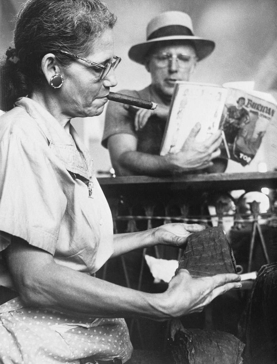 A lector reads a book to a worker in the Piedra Cigar factory in Maianao Cuba