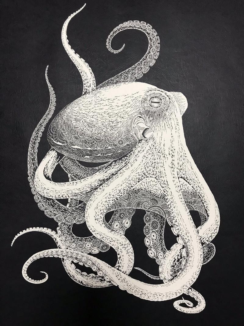 Тонкое японское искусство – осьминог, вырезанный из одного листа бумаги  1